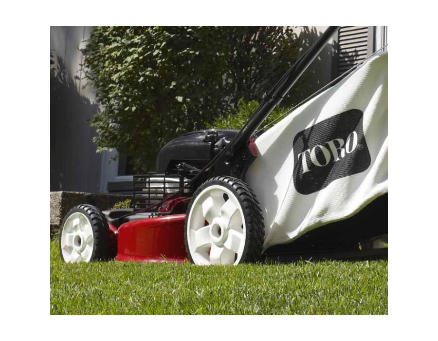 """The 11"""" high rear wheels combined with the variable speed self propel front wheel drive can tackle uneven terrain with ease."""